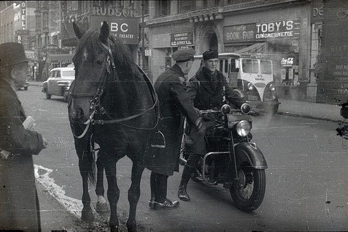 Two police officers  on a street in New York City, 1951