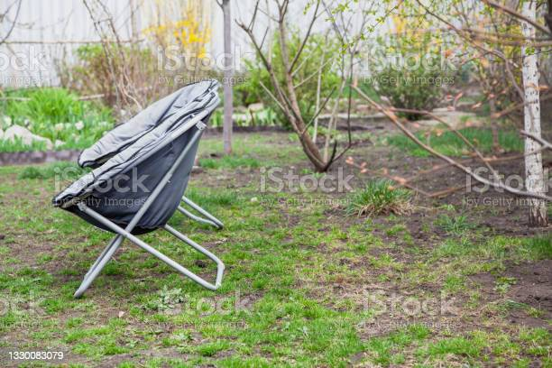 Photo of Two portable chairs stand in yard on grass