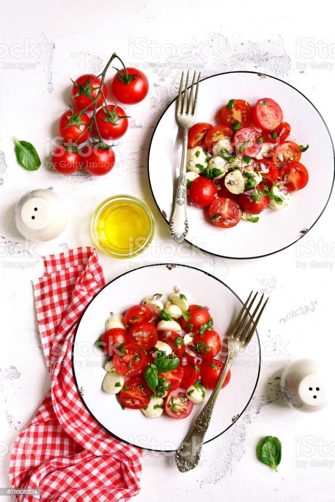 İki İtalyan Salata caprese bölümünü royalty-free stock photo