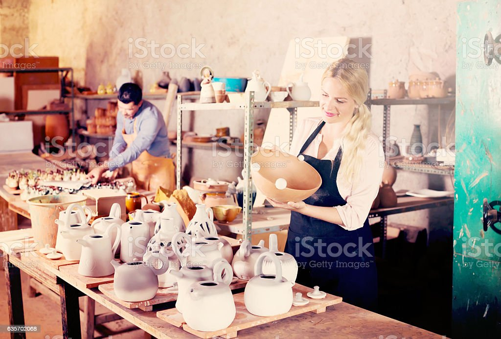 two potters working with ceramics in atelier royalty-free stock photo