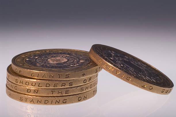Two Pound Coins Displaying Motto stock photo