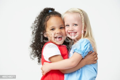 istock Two Pre School Girls Hugging One Another 465248071