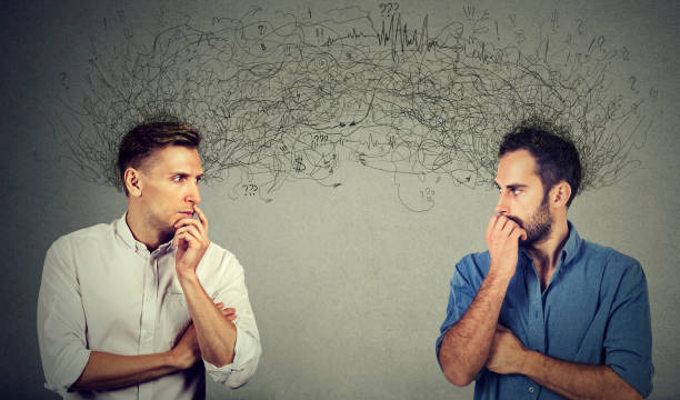 two preoccupied businessmen looking at each other exchanging with thoughts - row of heads stock photos and pictures