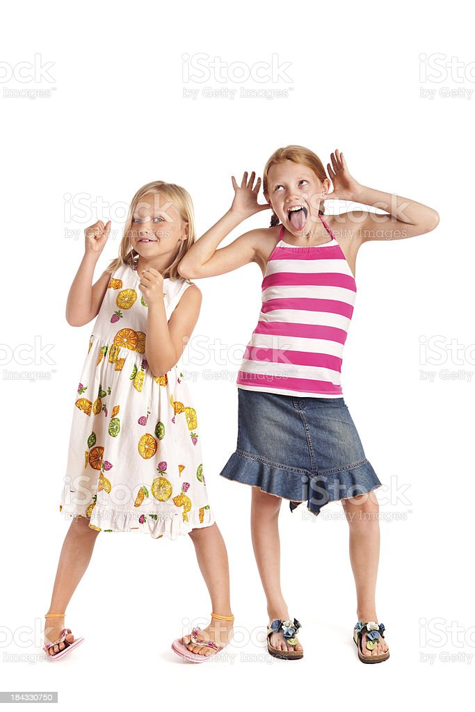 Two Preteen Adolescent Girls in Playful Poses on White Background stock photo