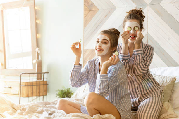 Two pretty girl friends having spa day stock photo