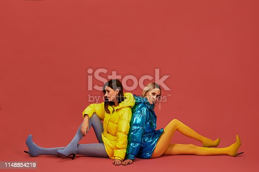 istock Two pretty girls in puffs posing for the camera in the studio 1148854219