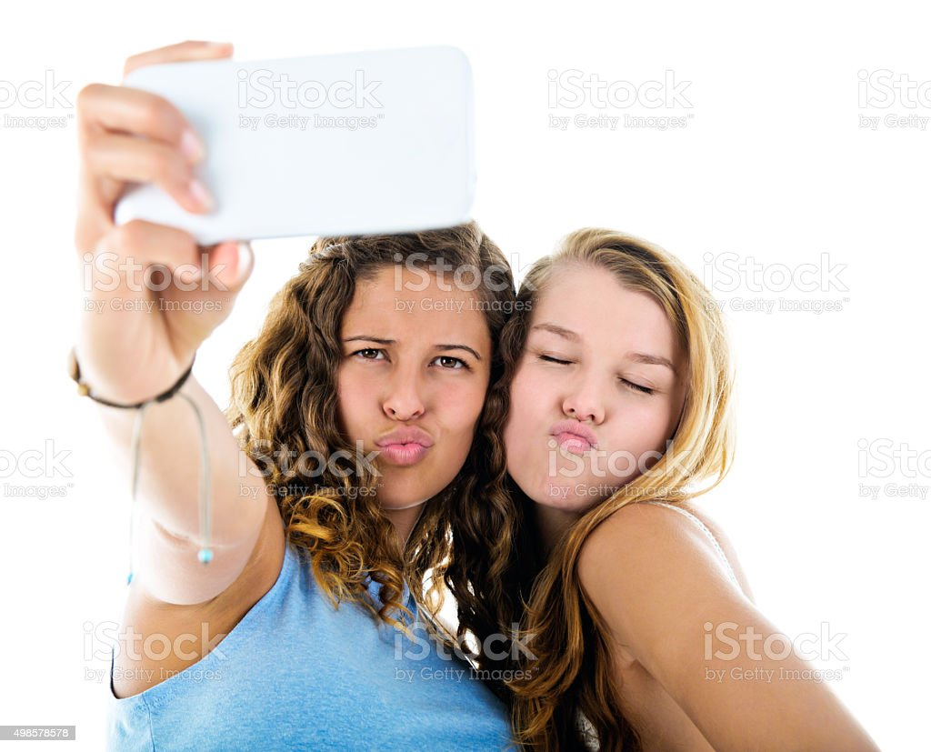 Two pretty girls take a selfie, pulling silly faces stock photo
