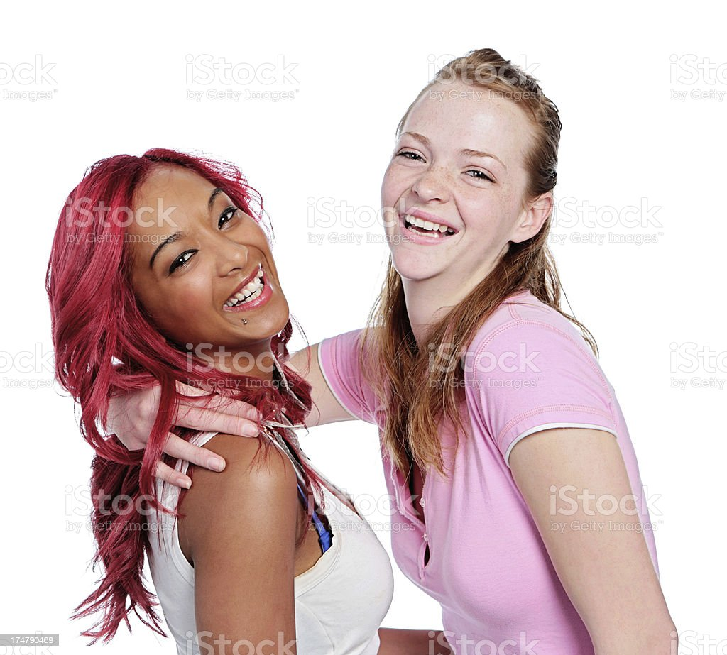 Two pretty young women friends hug and laugh together royalty-free stock photo