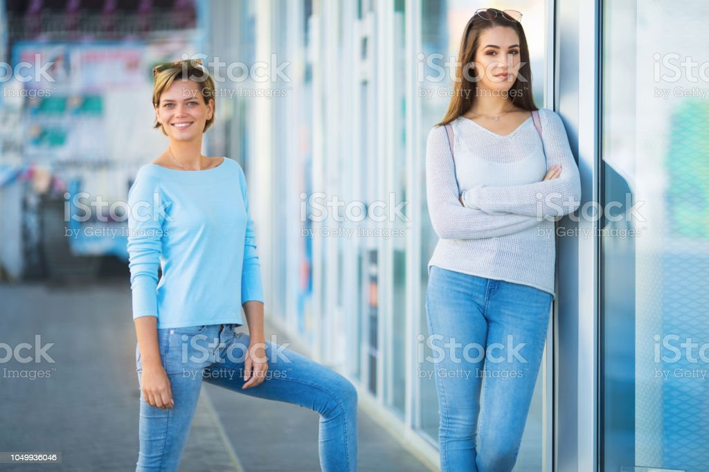 Two pretty young women in the city stock photo