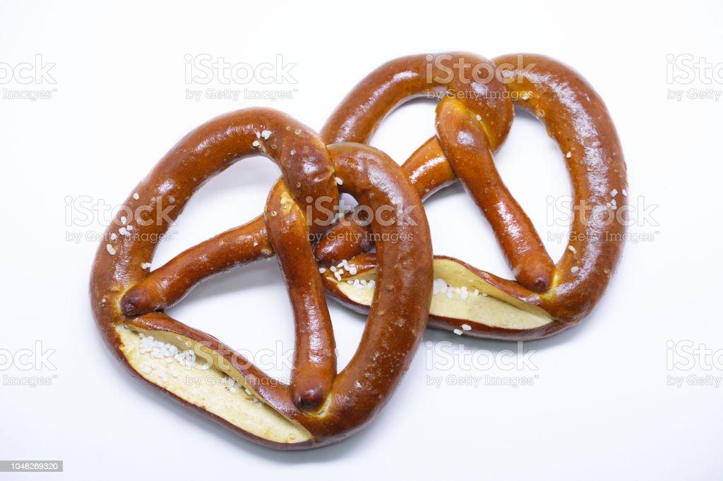 Two pretzels on white background. stock photo
