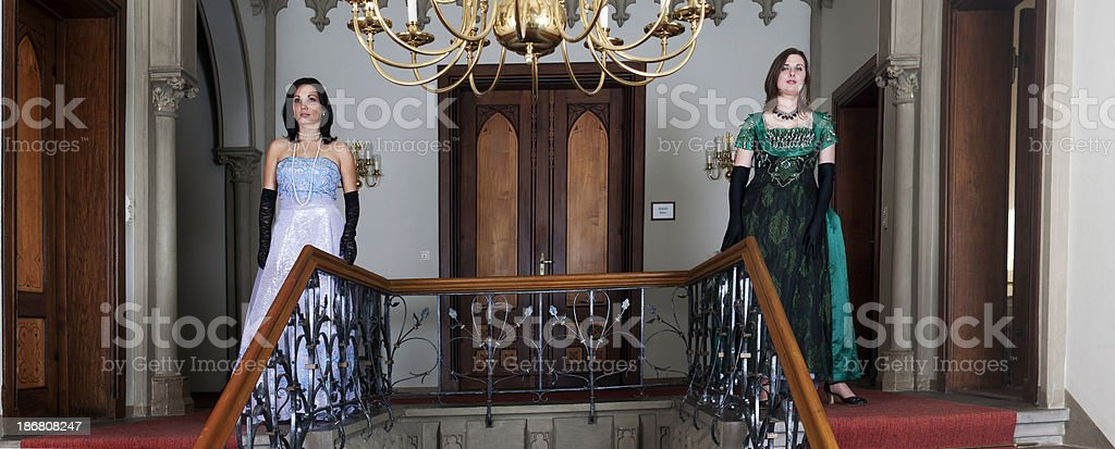 Two princesses in castle royalty-free stock photo