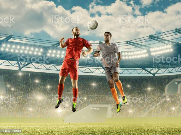 Two professinal soccer players fight for a ball in the air picture id1164101533?b=1&k=6&m=1164101533&s=612x612&h=lwusmv49gnhywo xzc2hzq26hnsgqmad6g1ntfm0phu=