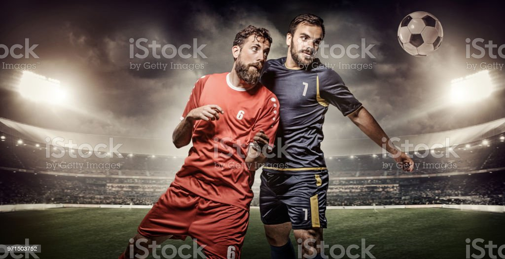 Two professional adult soccer team players competing for the ball...