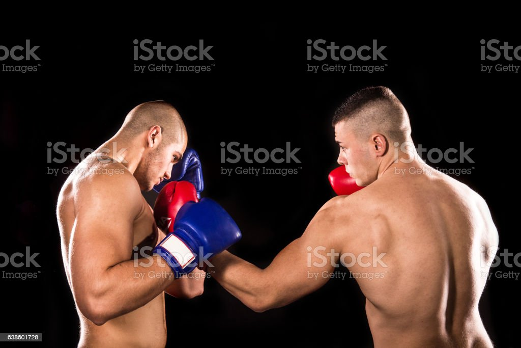 Two professional boxer isolated on black background stock photo