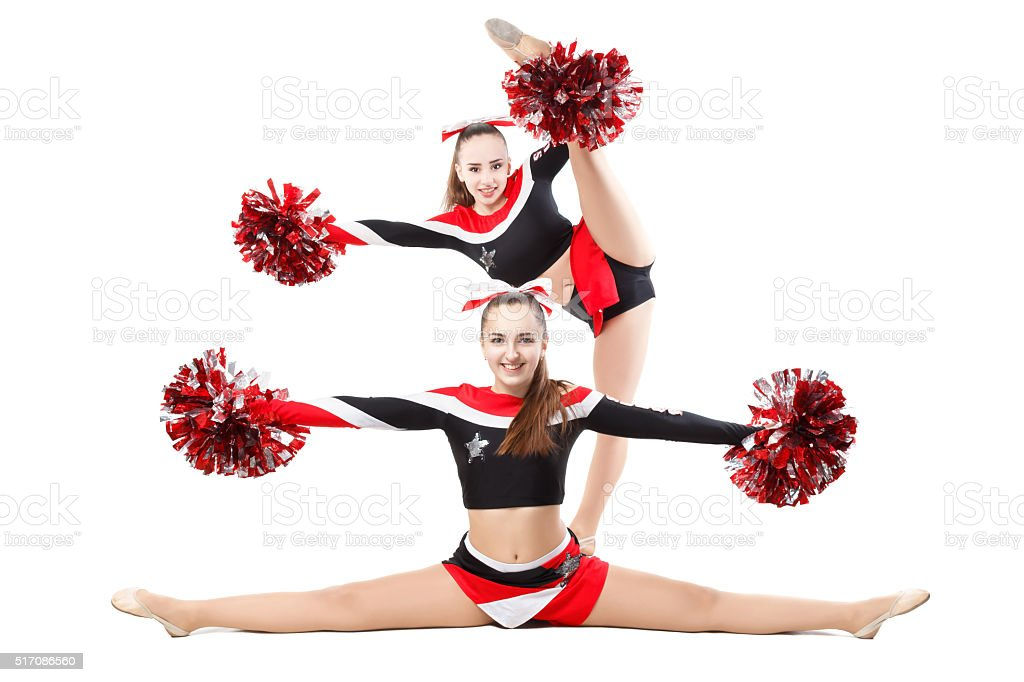 Two professional cheerleaders . Side split and vertical split. stock photo