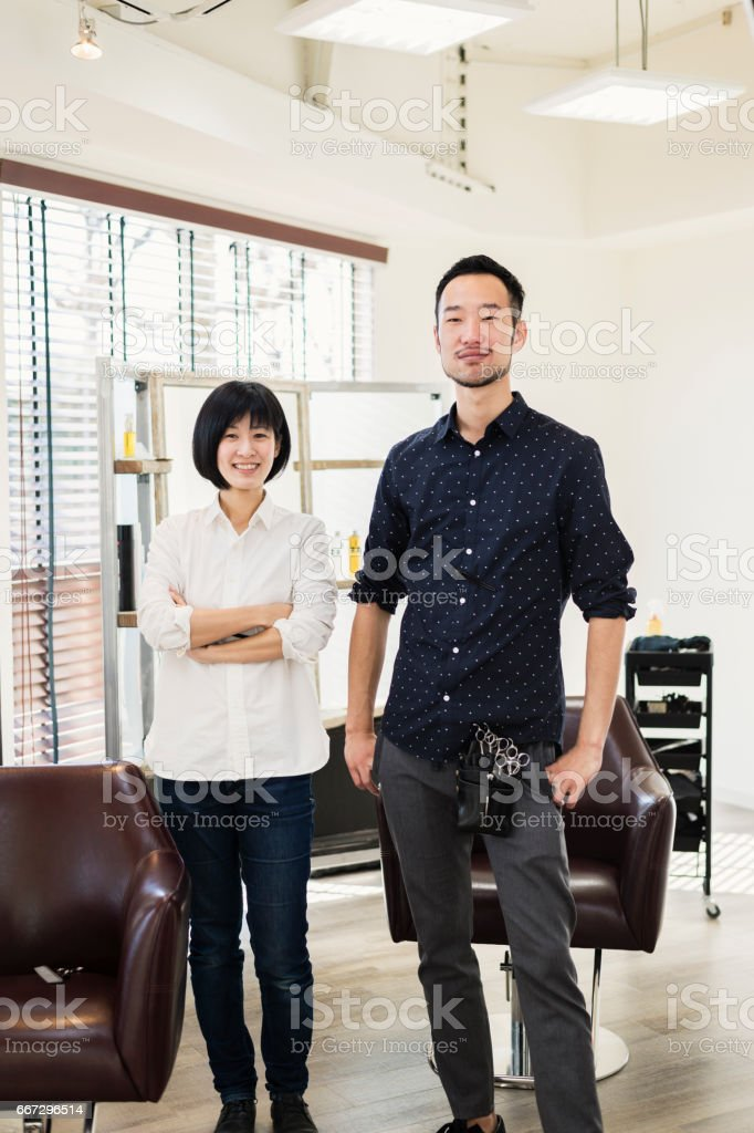 two professional hair stylist owners working in hair salon royalty free stock photo - Professional Hair Stylist