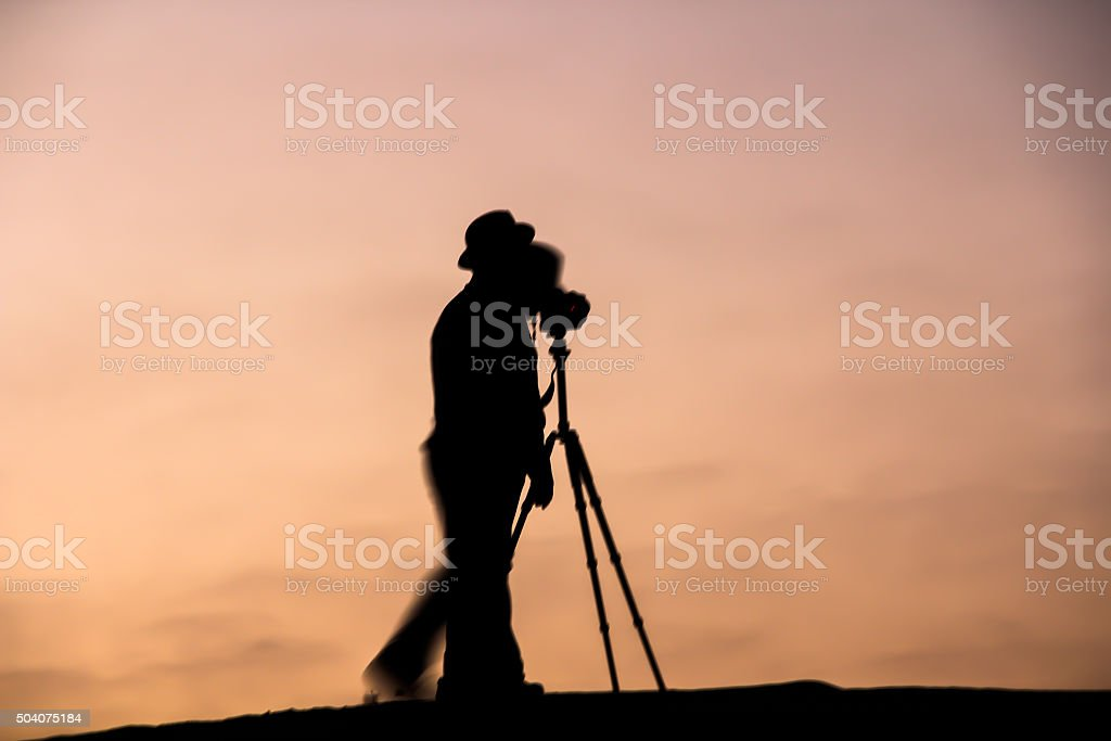 Two Professional Photographers during twilight hours stock photo