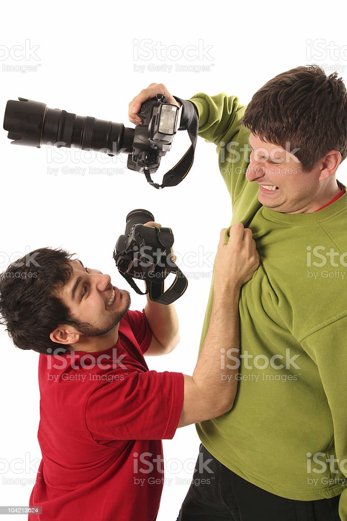 Two Professional photographers fighting  Adult Stock Photo