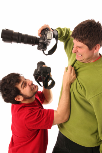 Two Professional Photographers Fighting Stock Photo - Download Image Now