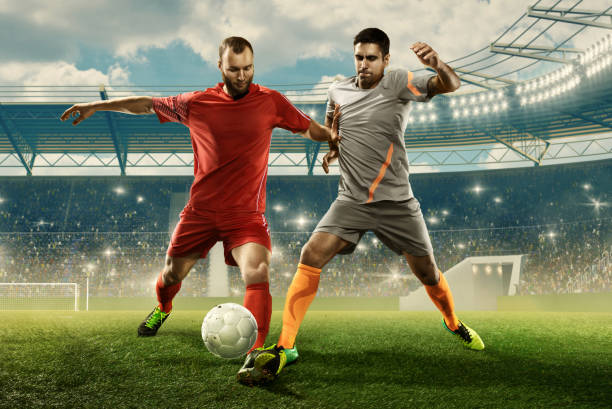 Two professional soccer players fight for a ball on a stadium picture id1163749856?b=1&k=6&m=1163749856&s=612x612&w=0&h=mzoeb78ixxjlxc4t8z31aposbxdpccpoj2hregfqfvc=