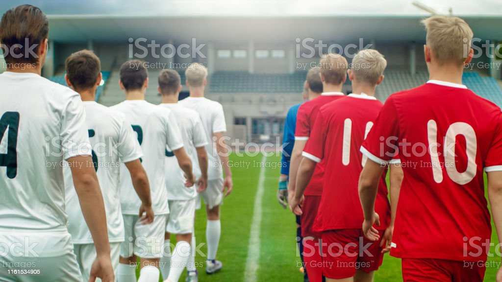Two Professional Soccer Teams Leaving The Field After Successful...