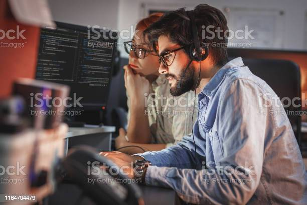 Two Programmers Working On New Project Stock Photo - Download Image Now