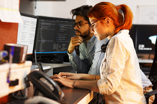 Two Programmers Working On New Projectthey Working Late At Night At The Office Stock Photo - Download Image Now