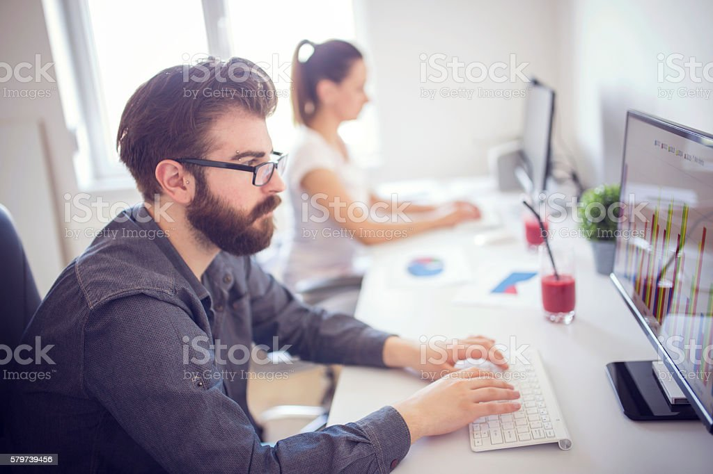 Two programmers working together stock photo