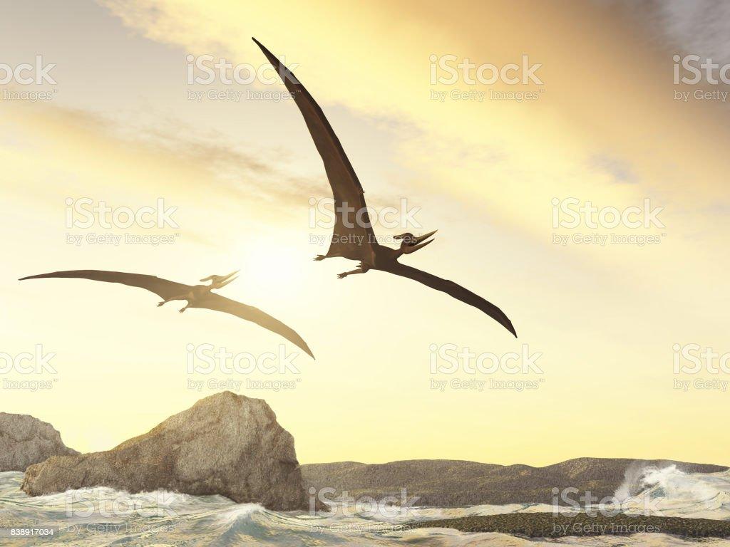 Zwei Pteranodons fliegen über Felsen im Meer – Foto