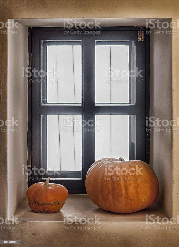 Two pumpkins on the window sill royalty-free stock photo
