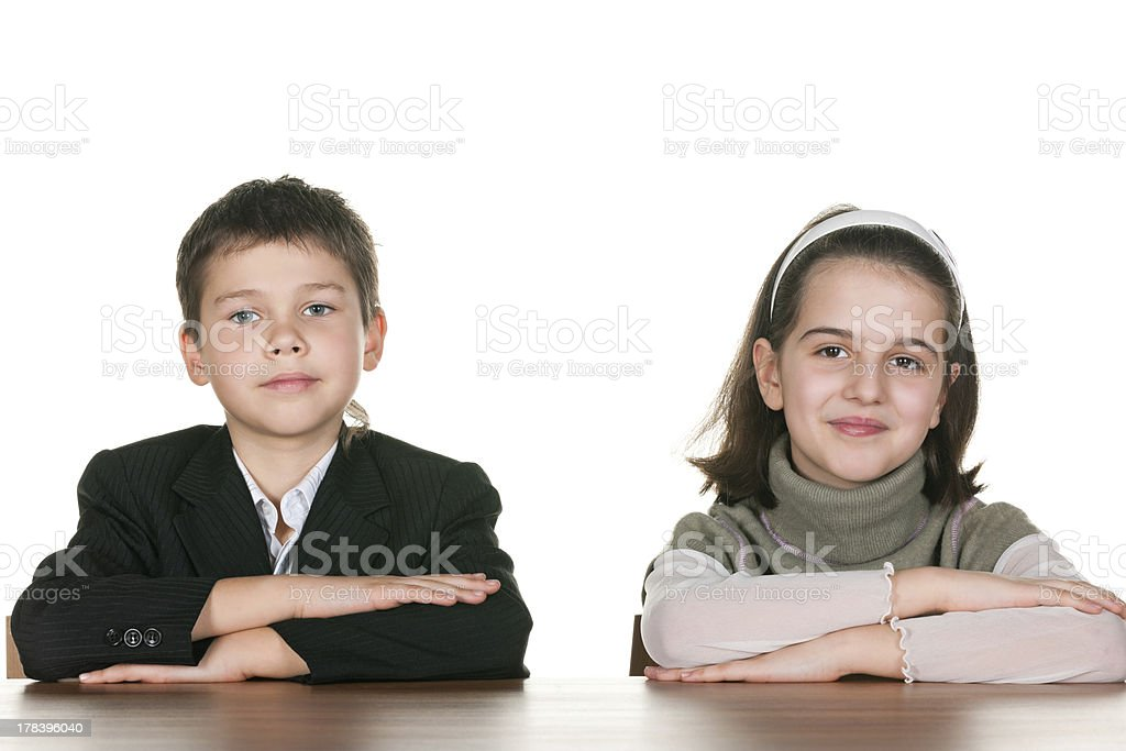 Two pupils at the desk stock photo