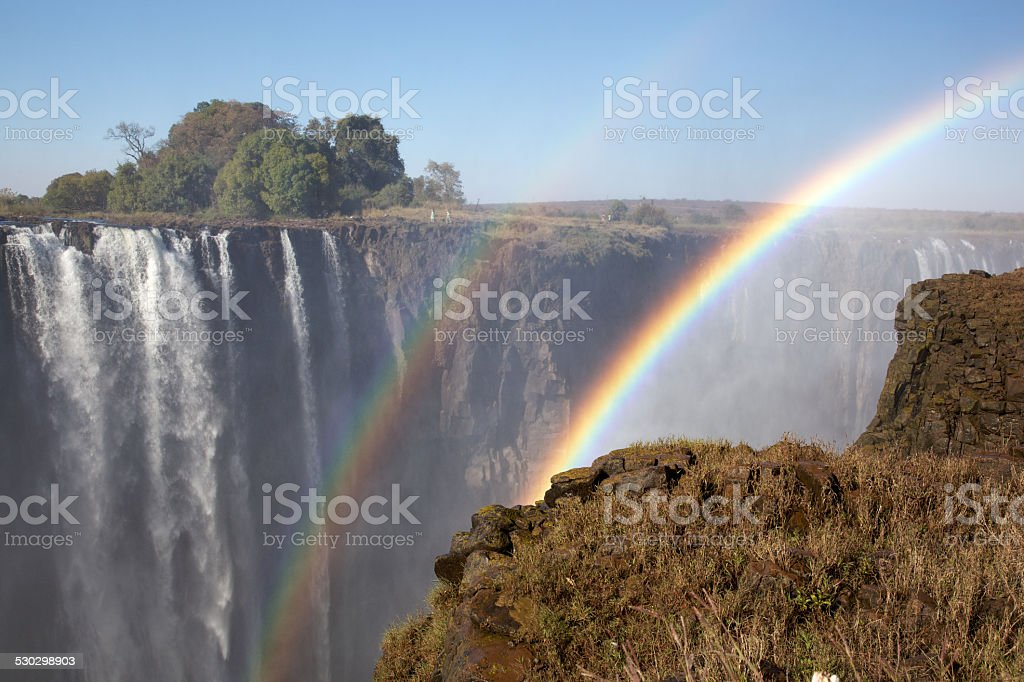 Two rainbows over Victoria Falls stock photo