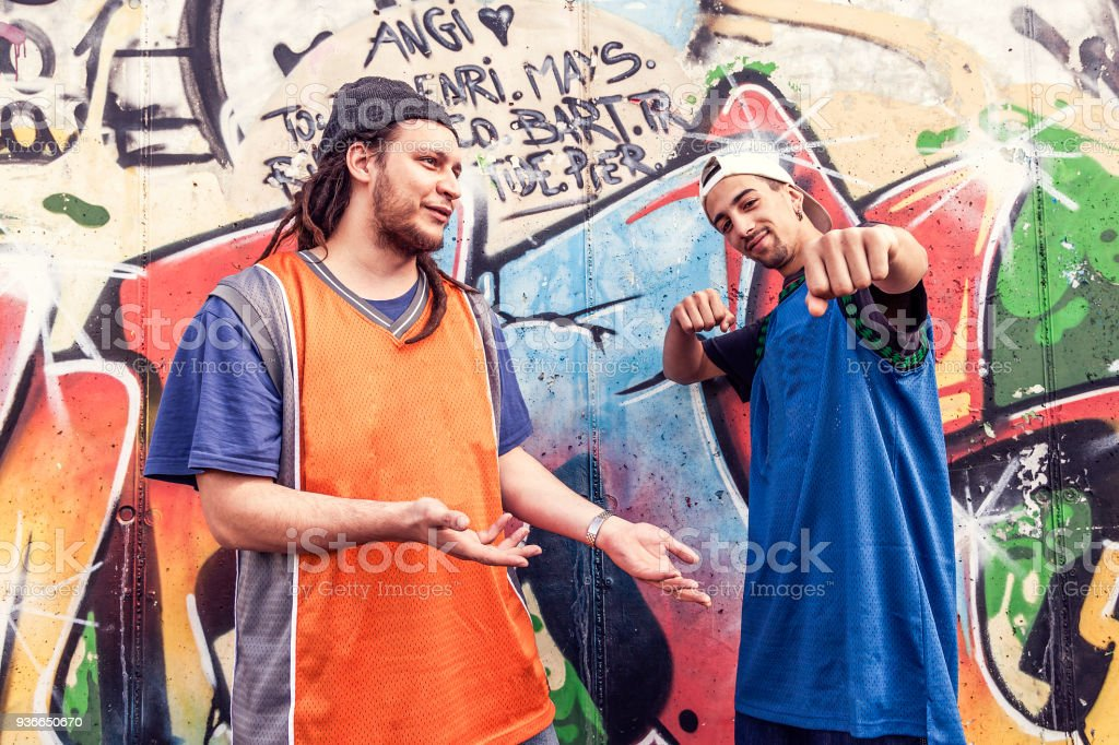 two rap singers in a subway with graffiti stock photo more