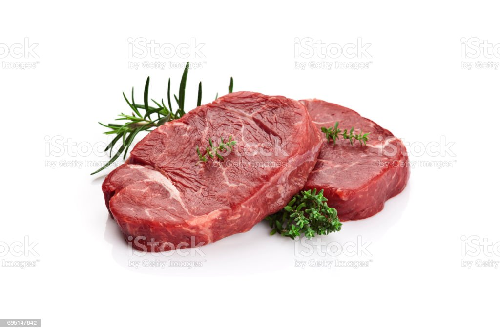 Two raw beef steaks on white background stock photo