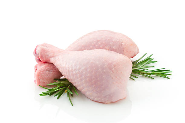 Two raw chicken legs on white backdrop  drumstick stock pictures, royalty-free photos & images