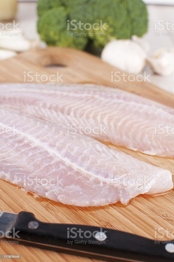 Two raw white fish fillet and knife royalty-free stock photo