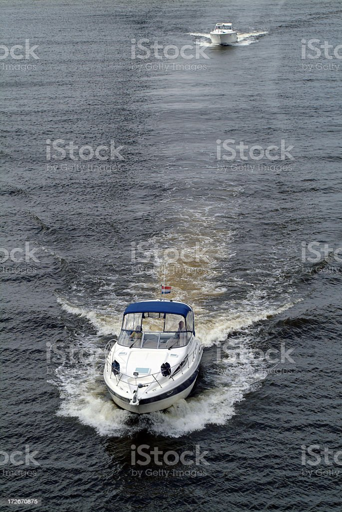 Two recreationel motorboats sailing on lake from above royalty-free stock photo