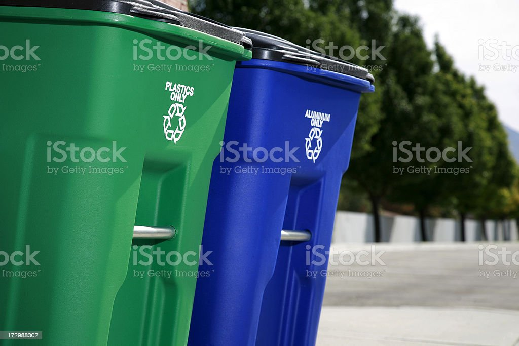 Two recycling bins placed outside royalty-free stock photo