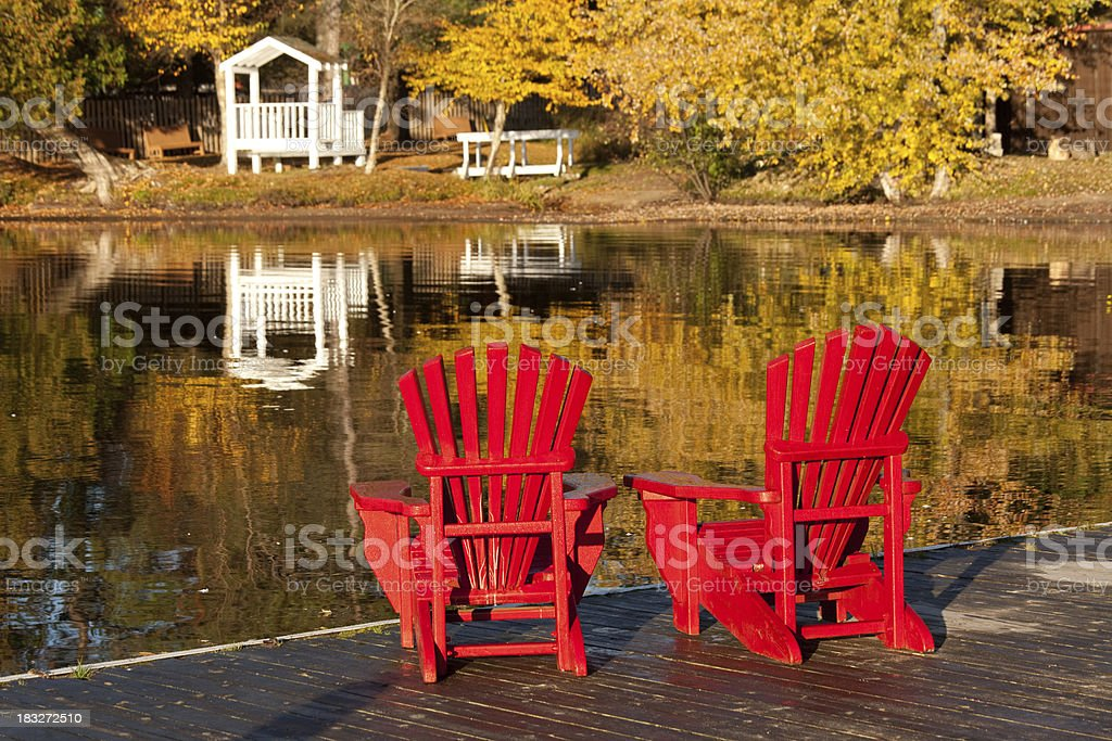 Adirondack Chairs On A Dock Stock Photo - Download Image