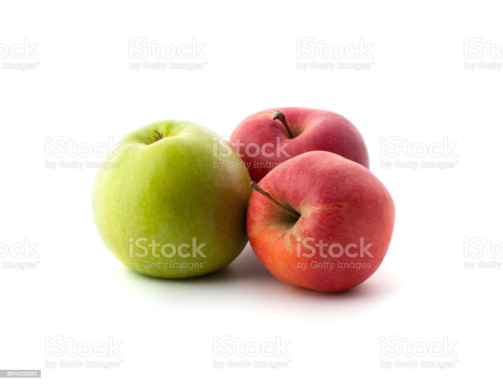 Two red and one green ripe apples on a white background. royalty-free stock photo