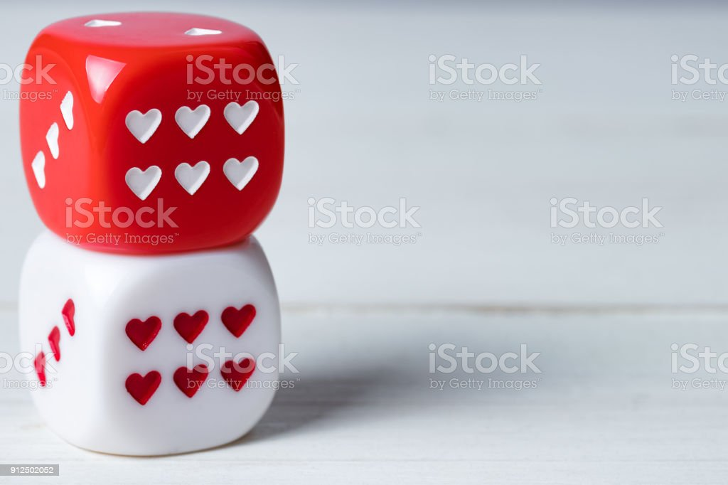 Two red and white Valentines Day heart dice. stock photo