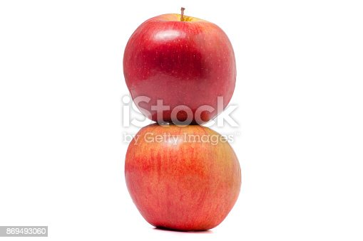 istock Two red apples isolated 869493060