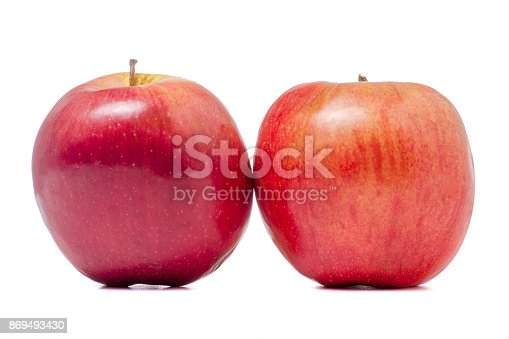 istock Two red apples isolated 869493430
