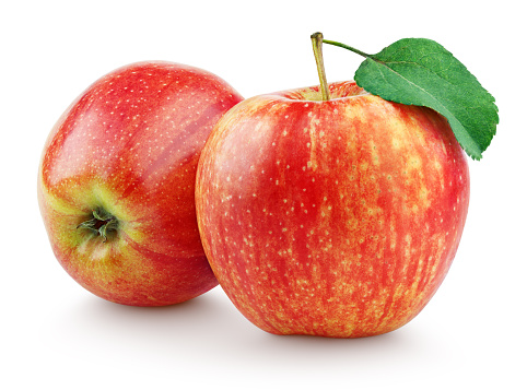 Two red apples with leaf isolated on white