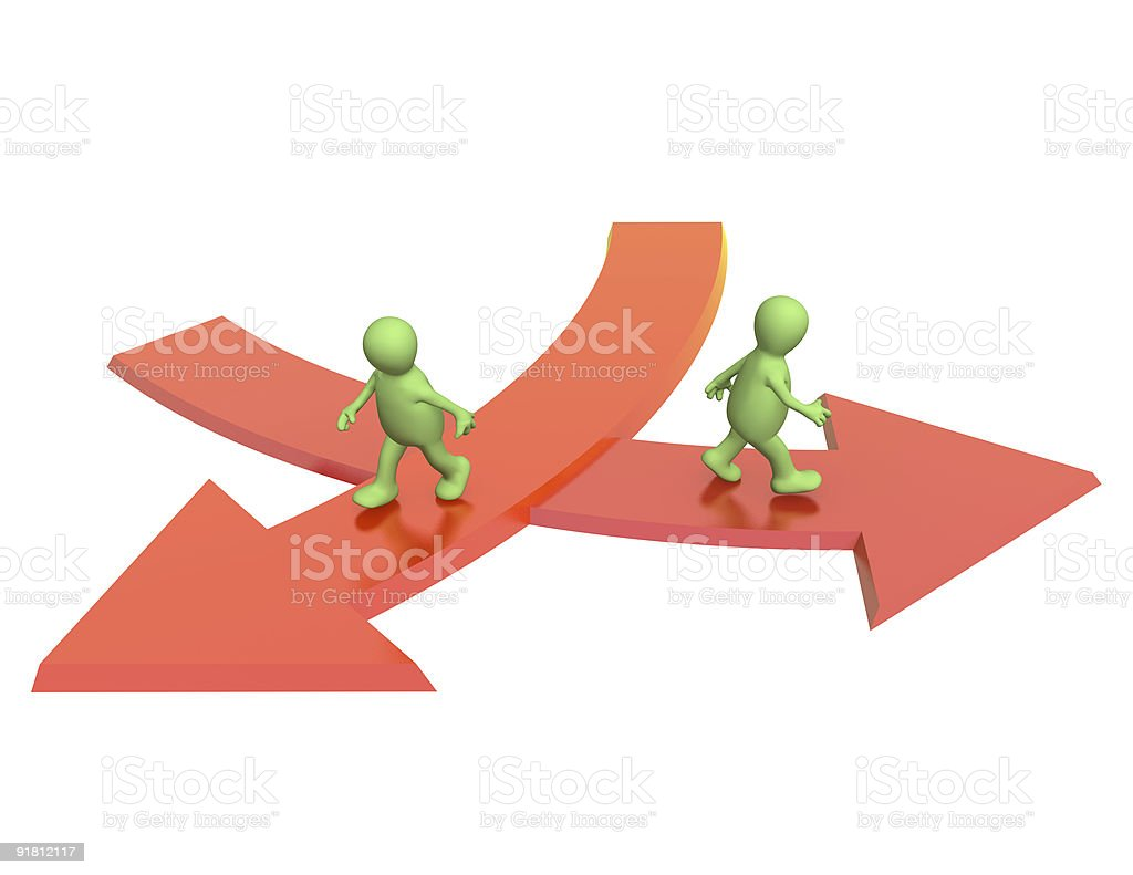Two red arrows with green men taking different directions stock photo