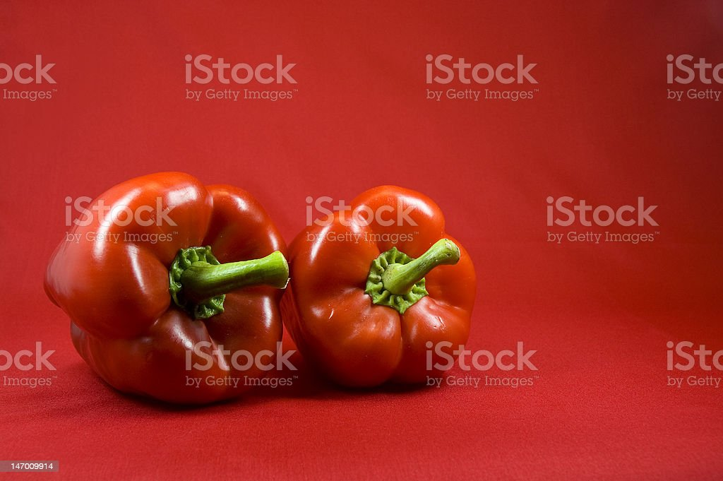 Two red bell peppers stock photo