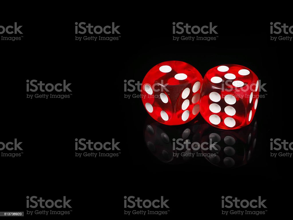 Two red casino dices with  reflection . black background stock photo