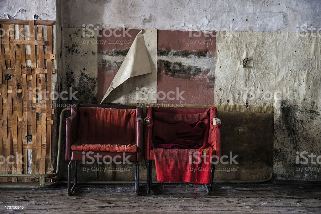 Two red chairs in an old room royalty-free stock photo