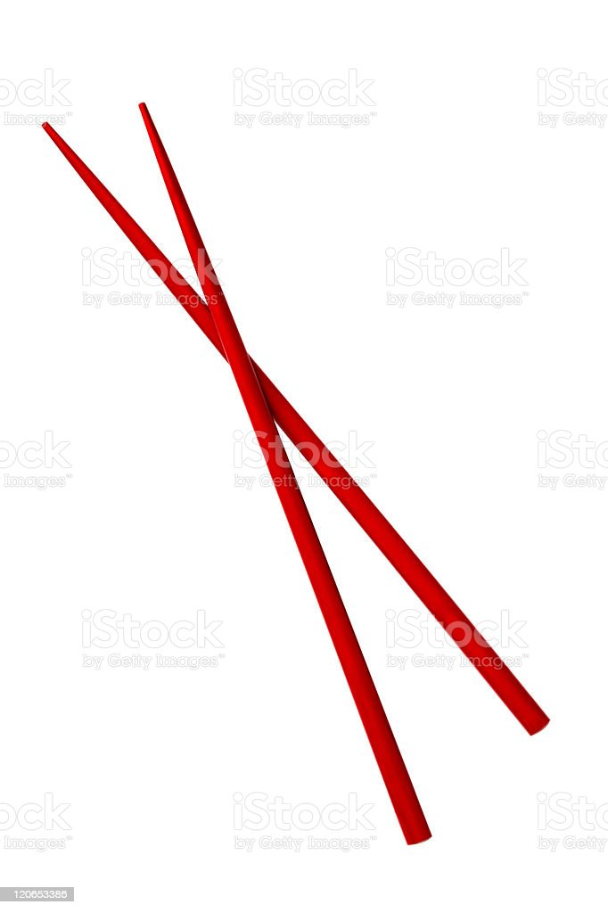 Two red chopsticks crossed on a white background stock photo
