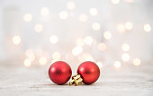 istock Two Red Christmas Balls On Wood Background 1072535420